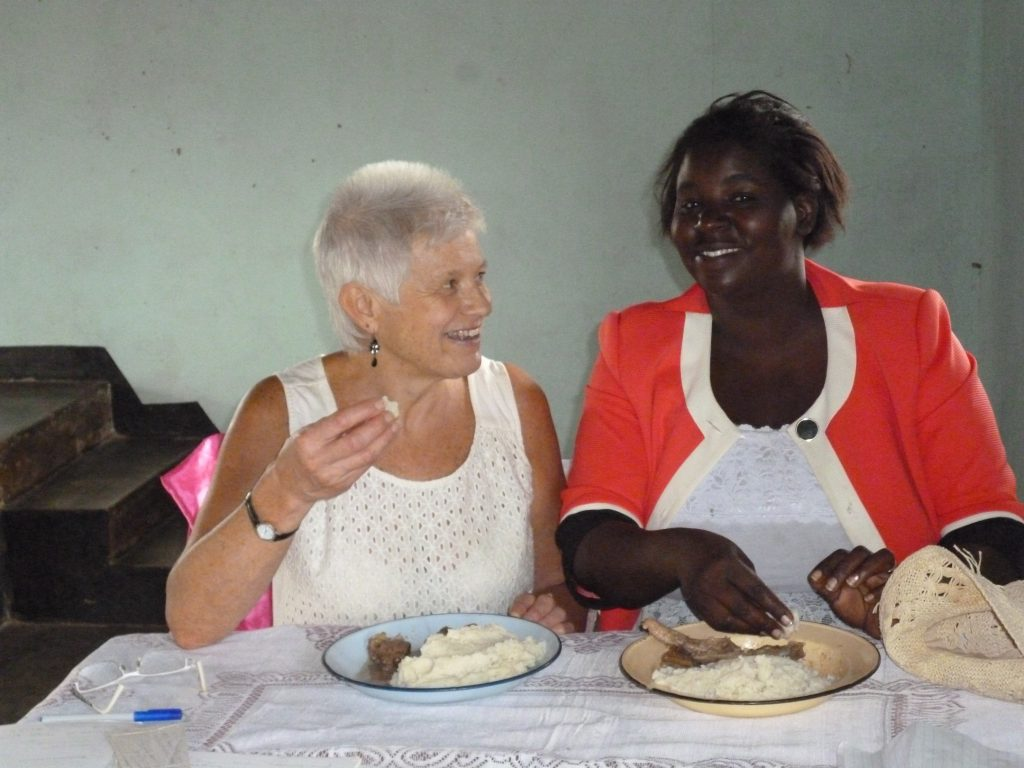 Joy and Sue enjoying a traditional meal